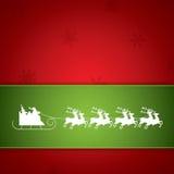 在驯鹿雪橇的圣诞老人乘驾 免版税库存图片