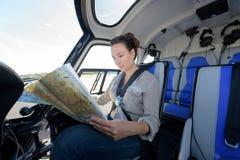 在驾驶舱的直升机试验学习的航线地图 免版税图库摄影