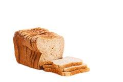 在高关键背景隔绝的切的棕色大面包 免版税库存图片
