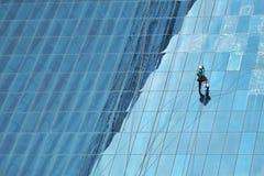 在高大厦的擦净剂 免版税库存照片