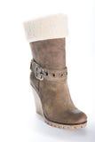 在高平台脚底的妇女的米黄绒面革起动 免版税库存图片