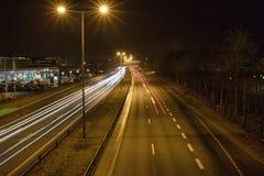 在高速公路的光足迹 免版税库存图片