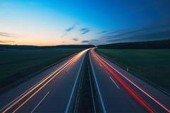 在高速公路的日出 免版税库存图片