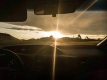 在高速公路的日落 库存照片