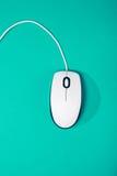 在鲜绿色背景的计算机老鼠 库存图片