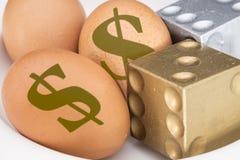 在鸡蛋的美元标志与切成小方块 库存图片
