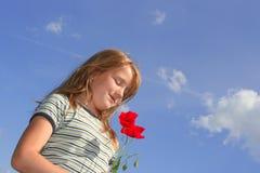 在鸦片天空的女孩 库存照片