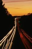 在黄昏的高速公路 图库摄影
