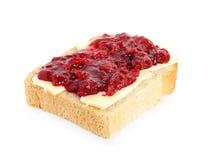 在黄油樱桃果酱上添面包 库存图片