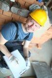 在黄色安全帽的男性建造者举行 库存图片