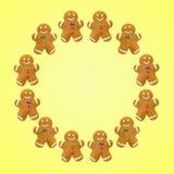 在黄色背景的圣诞节曲奇饼 曲奇饼圈子 免版税库存图片