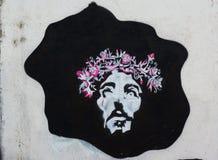 在黑小点的街道艺术耶稣 免版税图库摄影