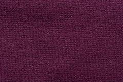 在黑暗的紫罗兰色颜色的最好纺织品背景 免版税库存照片