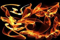 在黑暗的背景的抽象样式与橙色和黄线曲线微粒 库存照片