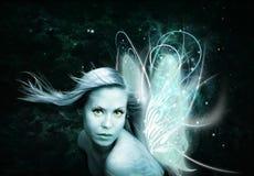 在黑暗的背景的神仙的妇女 免版税库存照片