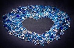 在黑暗的背景的蓝色假钻石 免版税库存照片