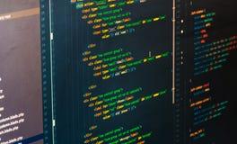 在黑暗的背景的Php代码在代码编辑 库存图片