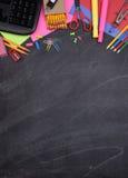 在黑板的学校用品有拷贝空间的 免版税图库摄影