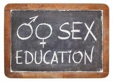 在黑板的性教育 免版税库存照片
