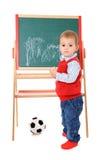 在黑板的逗人喜爱的小男孩图画 免版税库存图片
