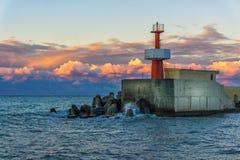 在黑海海岸的灯塔在日落 库存图片