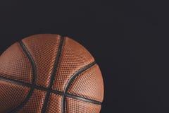 在黑背景拷贝空间的老篮球球 免版税库存照片