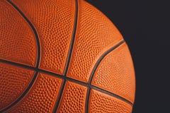 在黑背景特写镜头的篮球球 免版税库存图片