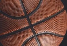 在黑背景特写镜头的老篮球球 免版税库存图片
