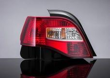 在黑背景的一个汽车车灯 免版税库存照片