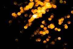 在黑背景的不可思议的光圣诞节bokeh 免版税图库摄影