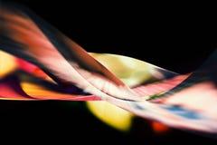 在黑背景的五颜六色的形状和曲线场面 免版税库存照片
