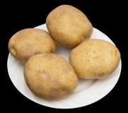 在黑背景的土豆 库存照片