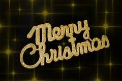 在黑背景的圣诞快乐金黄文本与星 库存图片
