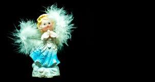 在黑背景的天使,孤立 库存照片