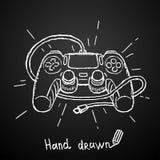 在黑背景的手拉的gamepad 也corel凹道例证向量 免版税库存照片