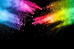 在黑背景的抽象多颜色粉末爆炸 库存图片