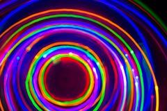 在黑背景的氖LED长的曝光 免版税库存照片