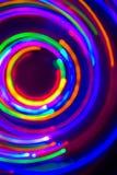 在黑背景的氖LED长的曝光 免版税图库摄影