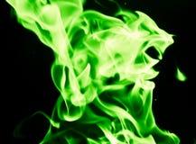 在黑背景的绿灯 免版税图库摄影