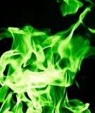 在黑背景的绿灯 免版税库存照片