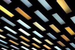在黑背景的色的天花板灯 库存照片