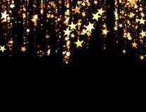 在黑背景的金黄星 免版税库存照片
