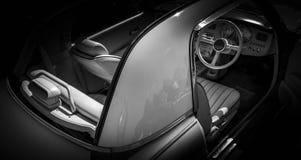 在黑背景的银色日产经典汽车 免版税库存照片
