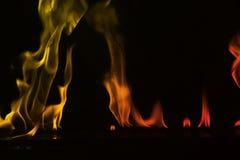 在黑背景隔绝的抽象火火焰 库存照片