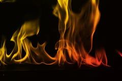 在黑背景隔绝的抽象火火焰 免版税库存照片