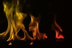 在黑背景隔绝的抽象火火焰 免版税图库摄影