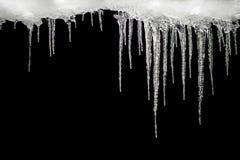 在黑背景,文本的,设计的模板空间的冰柱 图库摄影