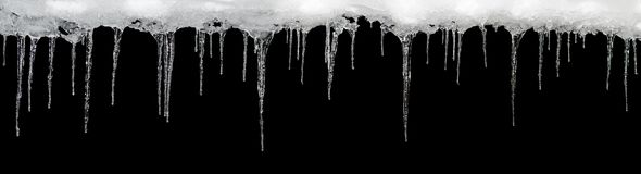 在黑背景,文本的,设计的模板空间的冰柱 免版税图库摄影
