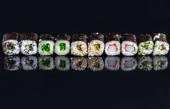 在黑背景13的寿司 库存照片