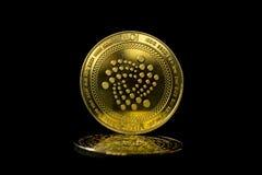 在黑背景2的隐藏货币硬币iota 图库摄影